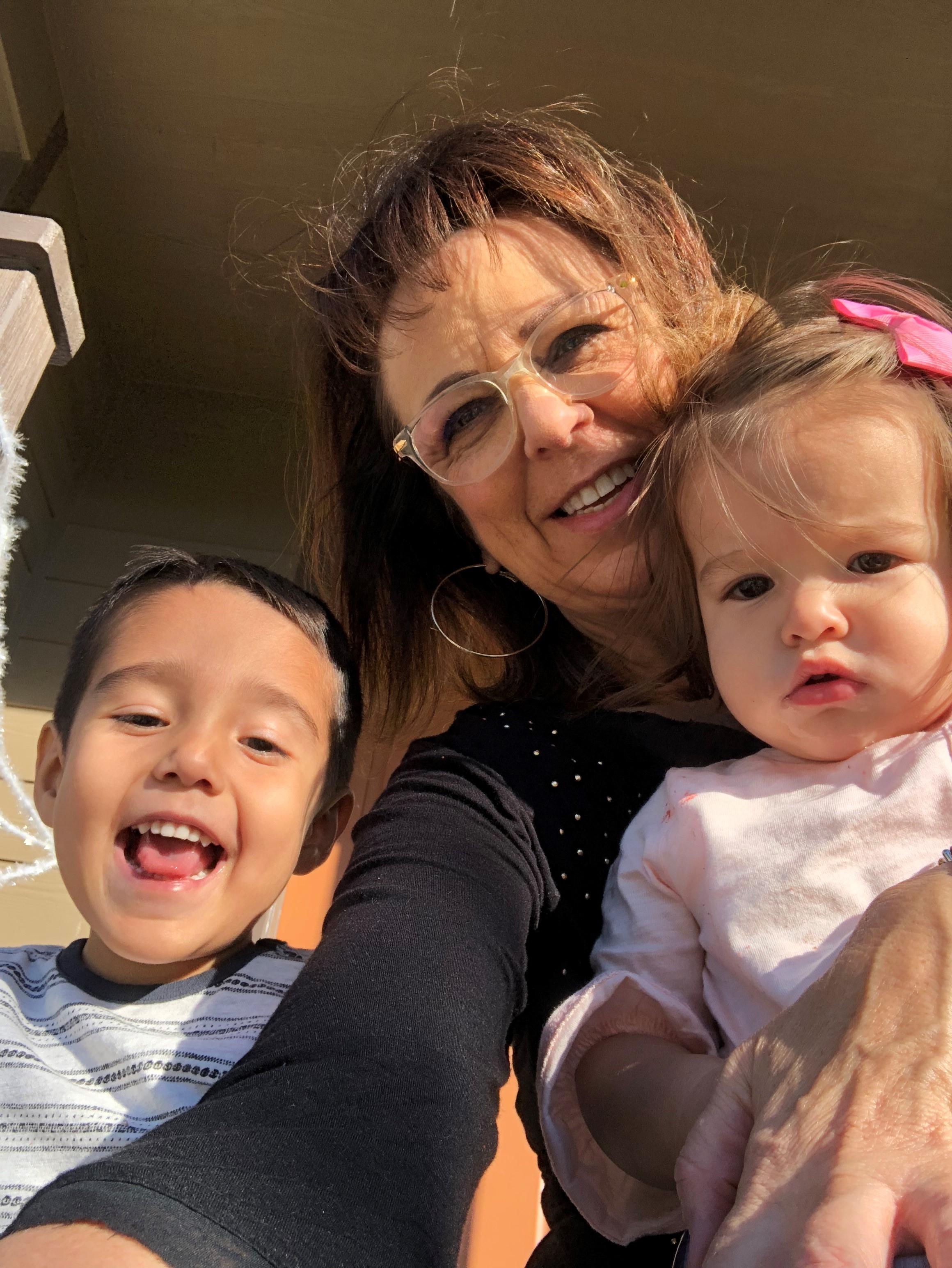 Karen Phillips with her grandkids.jpg