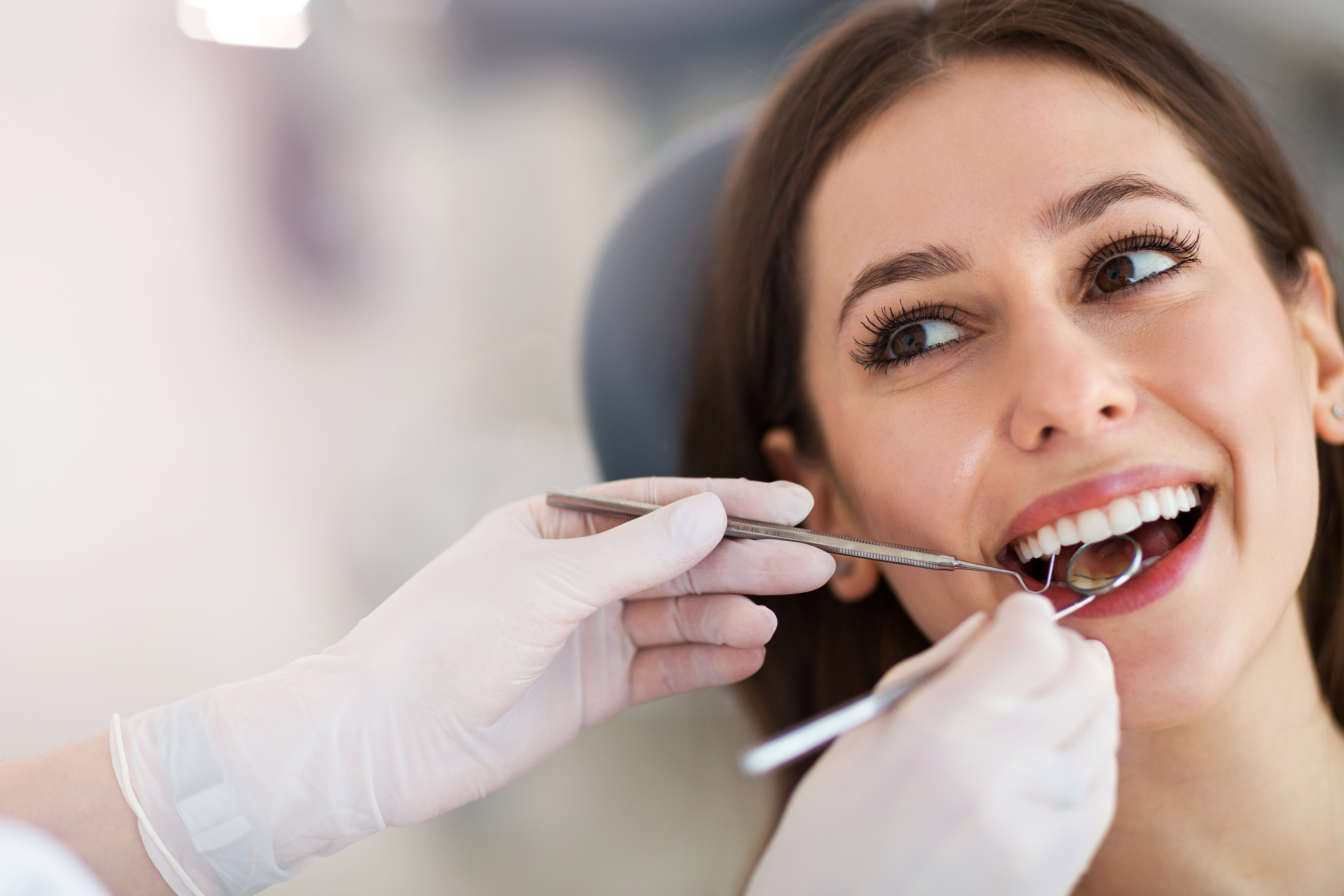 Woman in dental chair at dentist.jpg