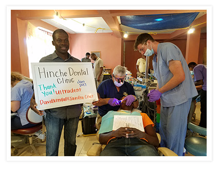Dr. Tim Brown works on a patient at his Haiti clinic using an Ultradent VALO curing light